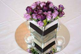 Mirrored square vase with purple roses