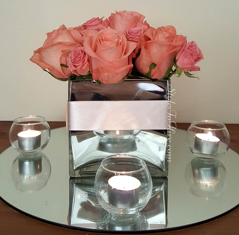Square mirrored vase with roses price TBA