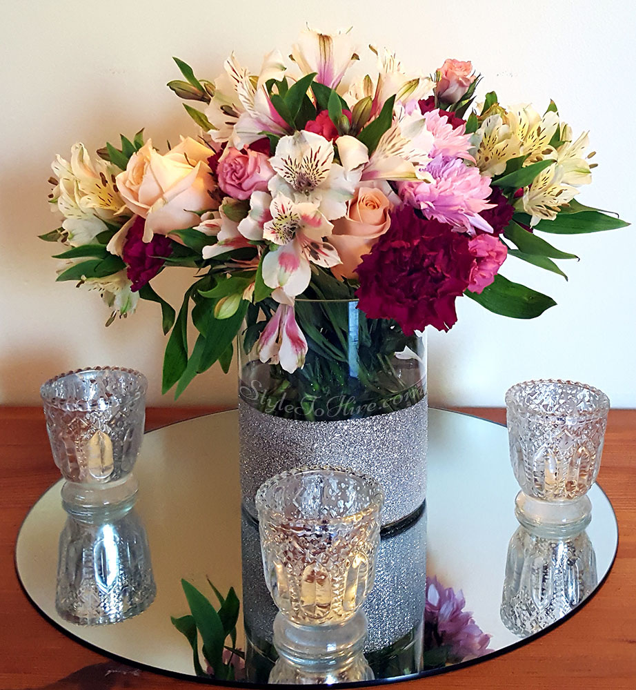Mixed blooms in silver glitter vase