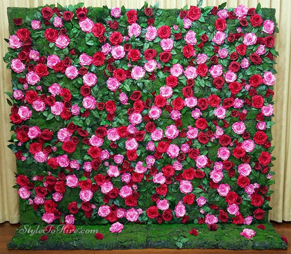 Red, hot pink flowers with greenery $275