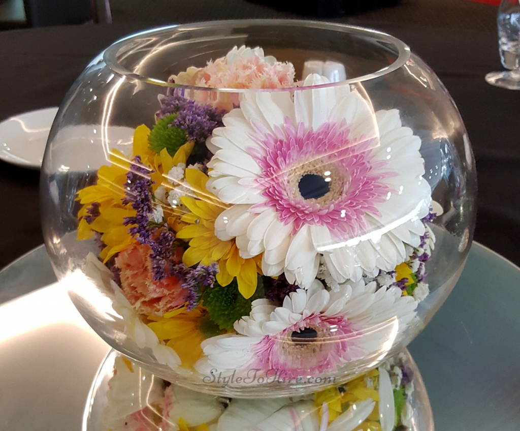 Fish bowl with bright seasonal florals