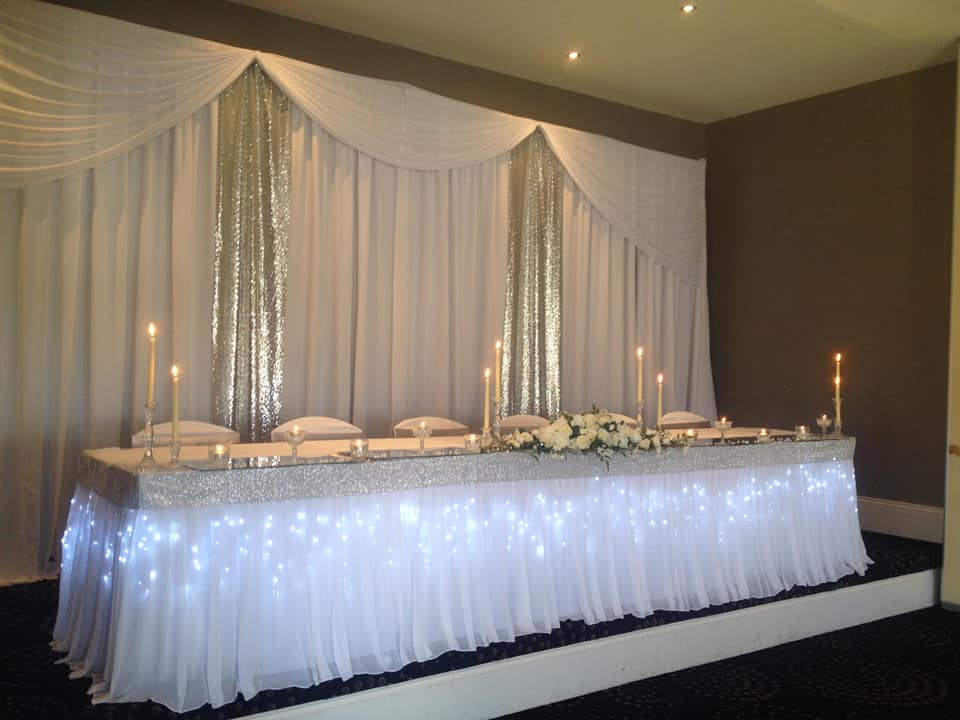drapery backdrop with silver sequin inserts