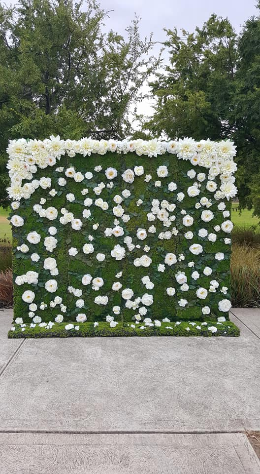 White florals and greenery flower wall $275