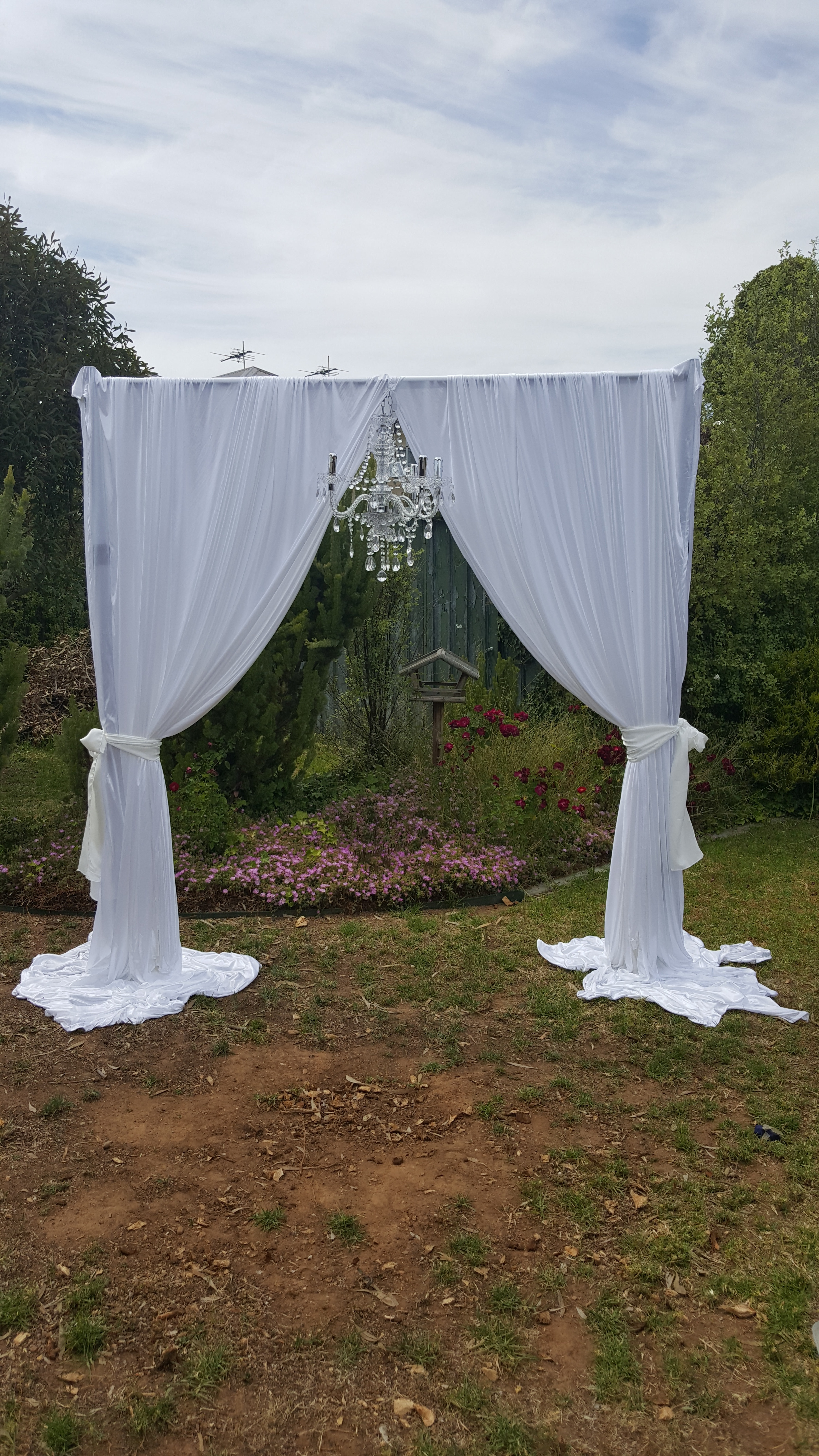 Drapery arch with chandelier $165