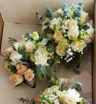 Pastel seasonal bridal bouquets in white cream apricot and greenery