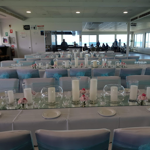 Glass vases with fresh blooms- Victor Harbour Bowling Club
