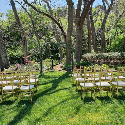 Chivari chairs in ceremony package with enchanted forest arch at Inglewood Farm