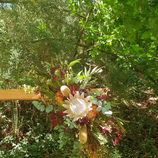 Native corner florals on wooden arch