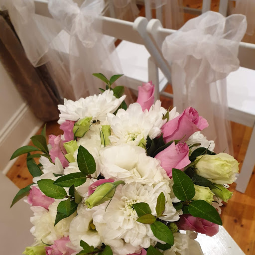 Seasonal blooms in cream/ white, pink with greenery posy