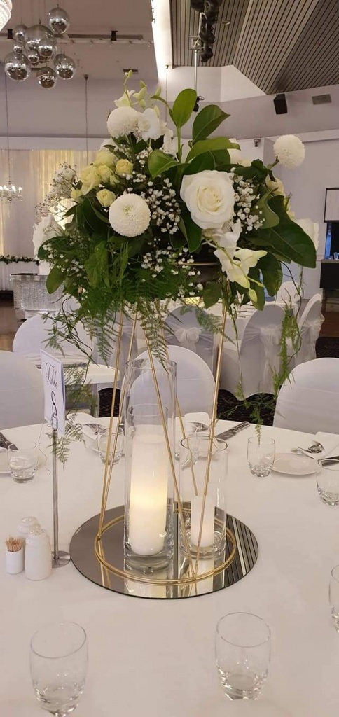 Gold stand with white, cream and greenery @ John Di Fede