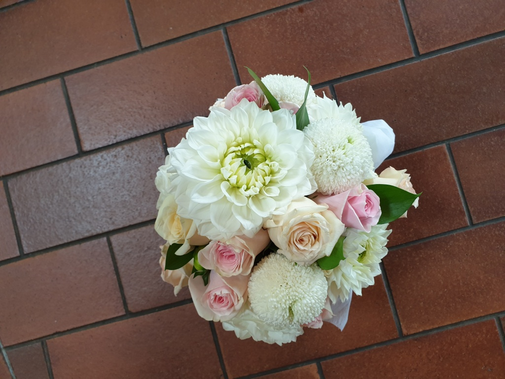 White, cream, pale pink and apricot tone seasonal bouquet