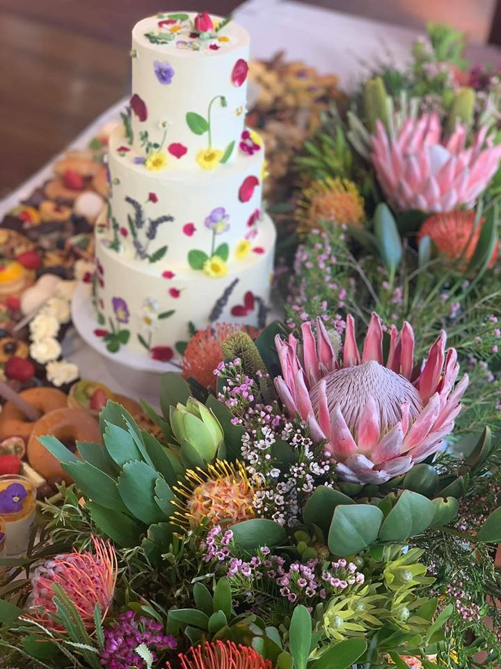 Native floral backdrop for dessert table by Dessert Table- Adelaide